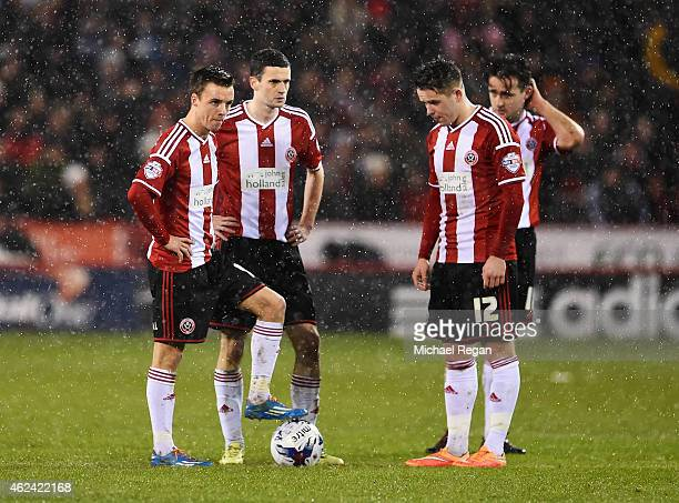 Sheffield United players look dejected after the opening goal scored by Christian Eriksen of Tottenham Hotspur during the Capital One Cup SemiFinal...