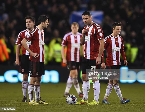 Sheffield United players look dejected after the second Tottenham goal scored by Christian Eriksen during the Capital One Cup SemiFinal Second Leg...