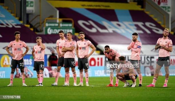 Sheffield United players look dejected during the penalty shoot out during the Carabao Cup second round match between Burnley and Sheffield United at...