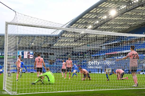 Sheffield United players react after conceding their sides first goal during the Premier League match between Brighton & Hove Albion and Sheffield...