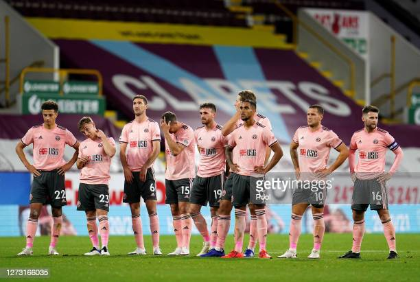Sheffield United players react during the penalty shoot out during the Carabao Cup second round match between Burnley and Sheffield United at Turf...