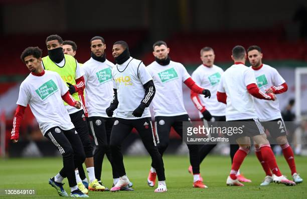 Sheffield United players warm up whilst wearing Level Playing Field t-shirts prior to the Premier League match between Sheffield United and...