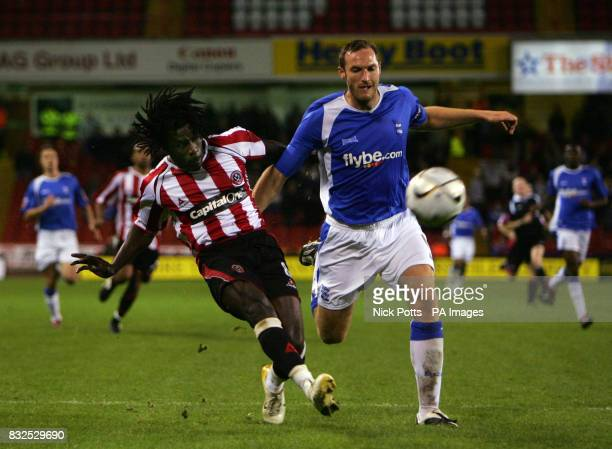 Sheffield United's Ade Akinbiyi has a shot past Birmingham City defender Martin Taylor during the Carling Cup third round at Bramall Lane Sheffield
