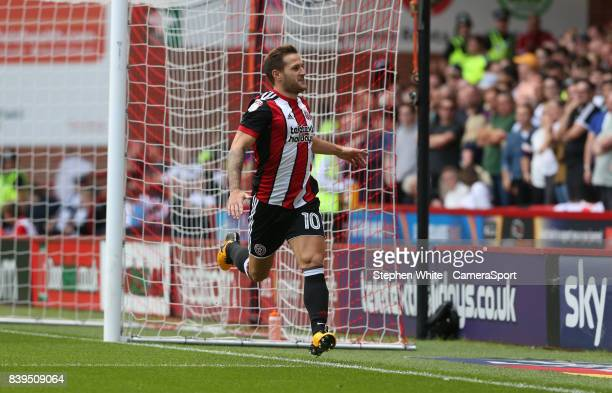 Sheffield United's Billy Sharp celebrates scoring the opening goal taunting the Derby County fans during the Sky Bet Championship match between...