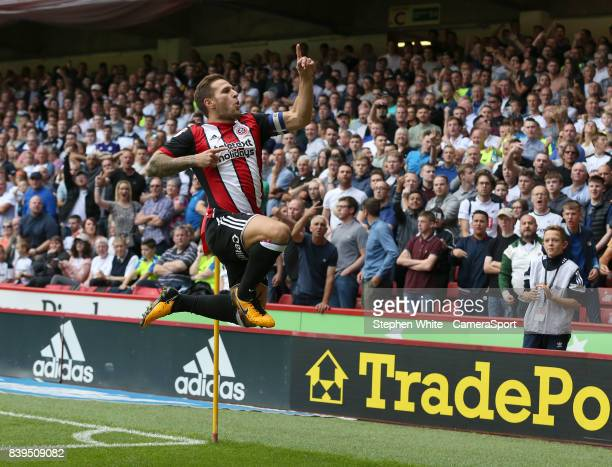 Sheffield United's Billy Sharp celebrates scoring the opening goal during the Sky Bet Championship match between Sheffield United and Derby County at...