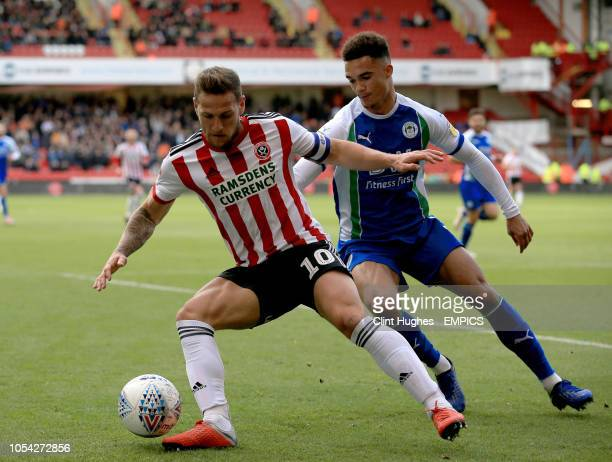 Sheffield United's Billy Sharp is tackled by Wigan Athletic's Antonee Robinson Sheffield United v Wigan Athletic Sky Bet Championship Bramall Lane