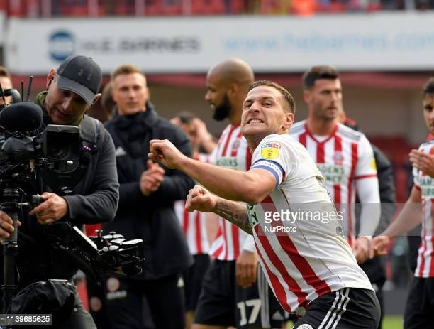 Sheffield United's captian Billy Sharp celebrate their win and promotion to the premiership at the end of their FA Championship football match...