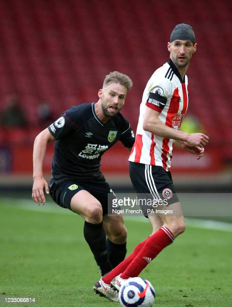 Sheffield United's Chris Basham and Burnley's Charlie Taylor battle for the ball during the Premier League match at Bramall Lane, Sheffield. Picture...