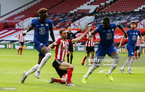 Sheffield United's Chris Basham battles with Chelsea's Tammy Abraham and Kurt Zouma during the Premier League match between Sheffield United and...