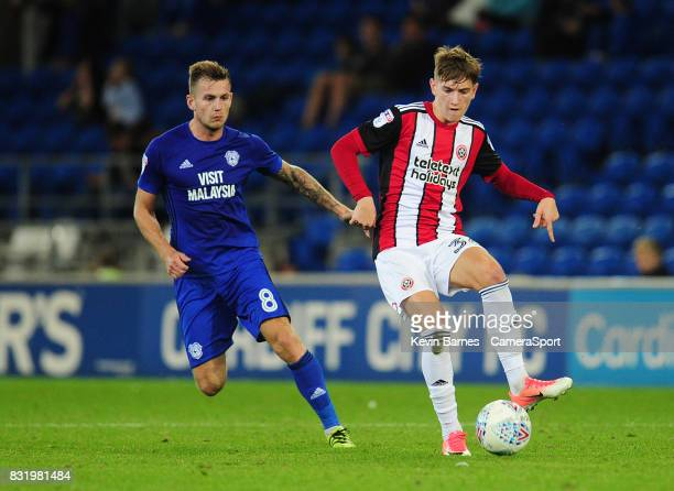 Sheffield United's David Brooks under pressure from Cardiff City's Joe Ralls during the Sky Bet Championship match between Cardiff City and Sheffield...