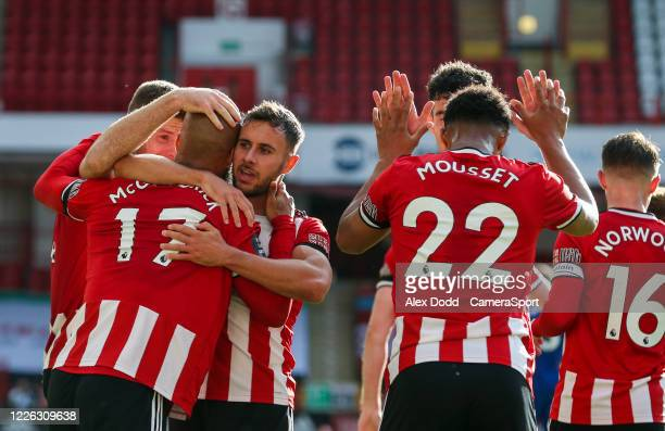 Sheffield United's David McGoldrick celebrates scoring his side's third goal with teammates during the Premier League match between Sheffield United...