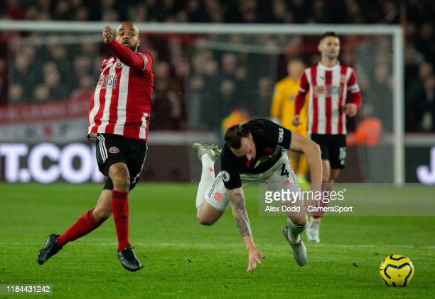 Sheffield United's David McGoldrick tangles with Manchester United's Phil Jones during the Premier League match between Sheffield United and...