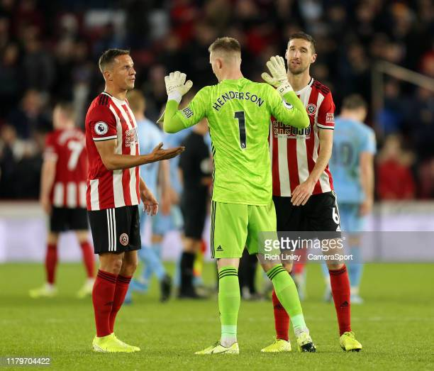 SHEFFIELD ENGLAND NOVEMBER Sheffield United's Dean Henderson celebrates with Phil Jagielka and Chris Basham at the final whistle during the Premier...