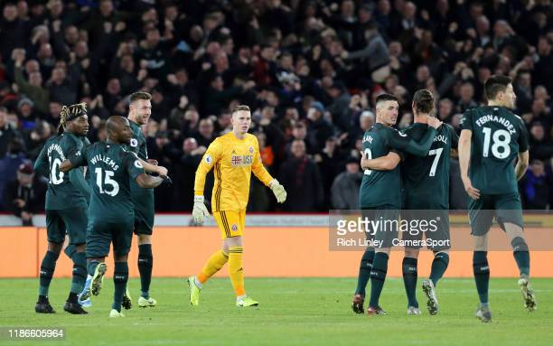 SHEFFIELD ENGLAND DECEMBER Sheffield United's Dean Henderson is stunned as Newcastle United celebrate a Jonjo Shelvey goal awarded by VAR during the...