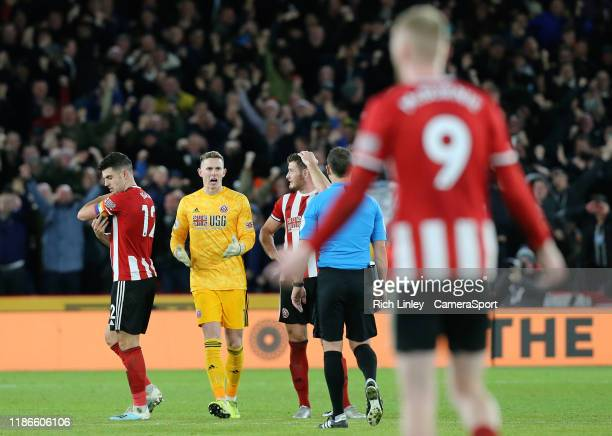 SHEFFIELD ENGLAND DECEMBER Sheffield United's Dean Henderson remonstrates with Referee Stuart Attwell after Newcastle United were awarded a Jonjo...