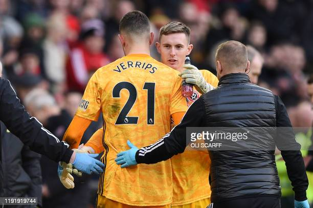 Sheffield United's Dutch goalkeeper Michael Verrips is replaced by Sheffield United's English goalkeeper Dean Henderson after picking up an injury...