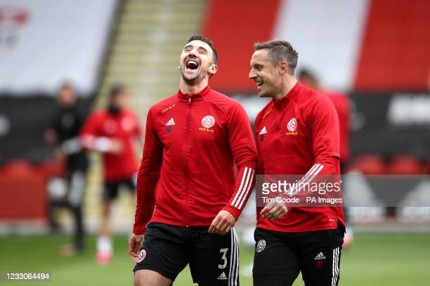 Sheffield United's Enda Stevens and Sheffield United's Phil Jagielka share a joke before the Premier League match at Bramall Lane, Sheffield. Picture...