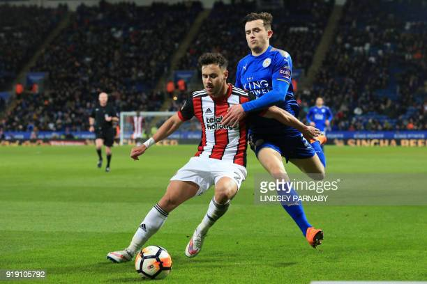 Sheffield United's English defender George Baldock vies with Leicester City's English defender Ben Chilwell during the English FA Cup fifth round...
