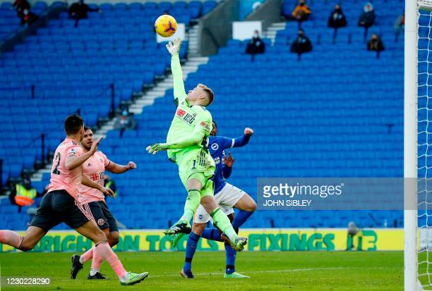 Sheffield United's English goalkeeper Aaron Ramsdale makes a save during the English Premier League football match between Brighton and Hove Albion...