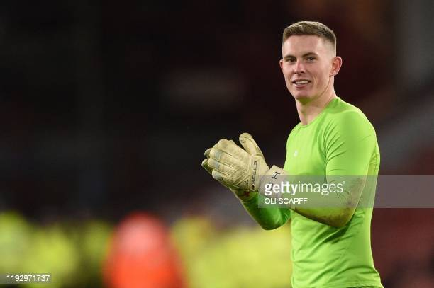 Sheffield United's English goalkeeper Dean Henderson celebrates at the end of the English Premier League football match between Sheffield United and...