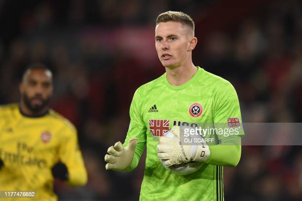 Sheffield United's English goalkeeper Dean Henderson gathers the ball during the English Premier League football match between Sheffield United and...