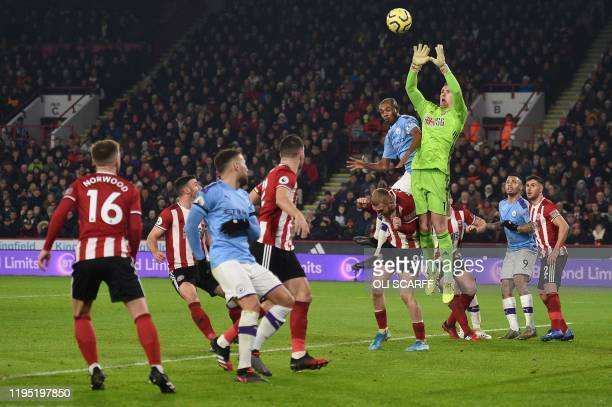 Sheffield United's English goalkeeper Dean Henderson jumps to catch the ball from a corner kick during the English Premier League football match...
