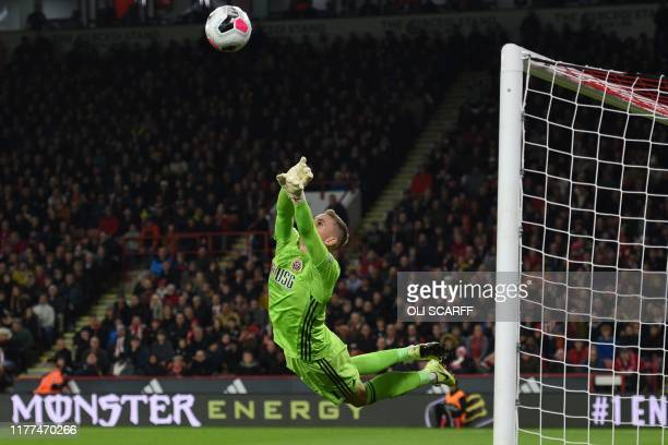 Sheffield United's English goalkeeper Dean Henderson makes a save during the English Premier League football match between Sheffield United and...