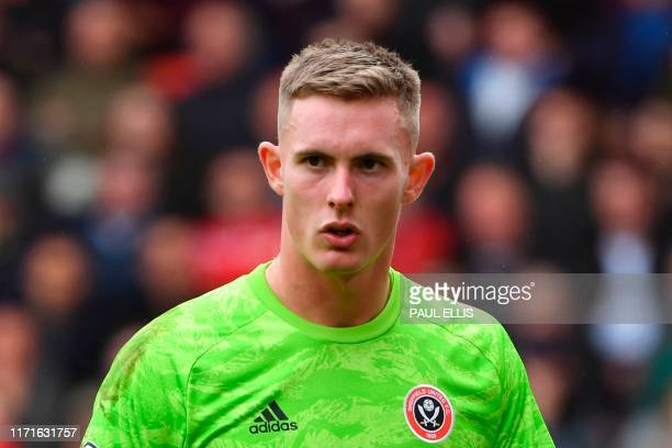 Sheffield United's English goalkeeper Dean Henderson reacts during the English Premier League football match between Sheffield United and Liverpool...