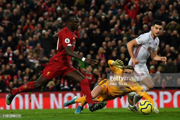 Sheffield United's English goalkeeper Dean Henderson saves a shot from Liverpool's Senegalese striker Sadio Mane during the English Premier League...