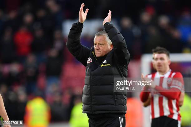 Sheffield United's English manager Chris Wilder applauds supporters on the pitch after the English Premier League football match between Sheffield...