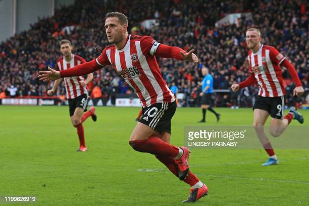 Sheffield United's English striker Billy Sharp celebrates after scoring their first goal during the English Premier League football match between...