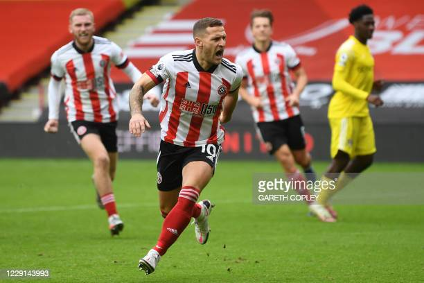 Sheffield United's English striker Billy Sharp celebrates after scoring their first goal from the penalty spot during the English Premier League...