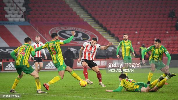 Sheffield United's English striker Billy Sharp shoots to score their second goal during the English Premier League football match between Sheffield...