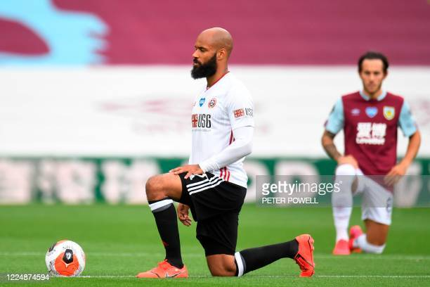 Sheffield United's English-born Irish striker David McGoldrick takes a knee to protest against racism and show solidarity with the Black Lives Matter...
