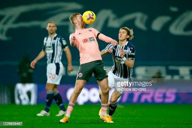 Sheffield United's Englishborn Scottish striker Oli McBurnie controls the ball in front of West Bromwich Albion's English midfielder Conor Gallagher...