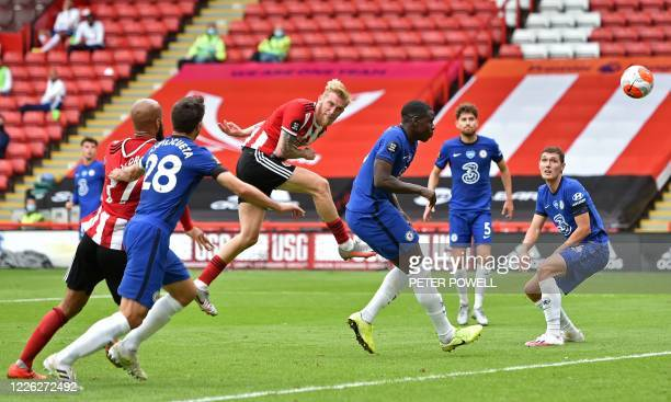 Sheffield United's English-born Scottish striker Oliver McBurnie heads home their second goal during the English Premier League football match...