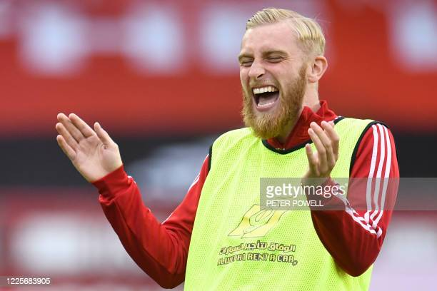 Sheffield United's English-born Scottish striker Oliver McBurnie laughs during the warm up prior to the English Premier League football match between...