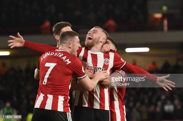TOPSHOT Sheffield United's Englishborn Scottish striker Oliver McBurnie celebrates scoring the opening goal during the English Premier League...