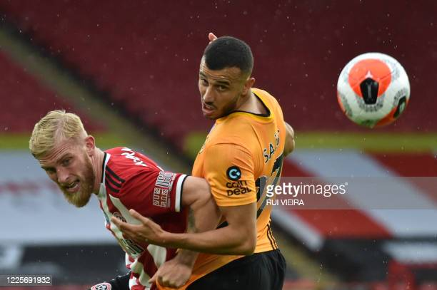 Sheffield United's Englishborn Scottish striker Oliver McBurnie vies with Wolverhampton Wanderers' Moroccan midfielder Romain Saiss during the...
