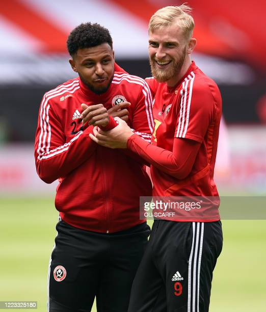 Sheffield United's French striker Lys Mousset and Sheffield United's Englishborn Scottish striker Oliver McBurnie take part in the warm up ahead of...