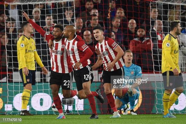 Sheffield United's French striker Lys Mousset celebrates with teammates after scoring the opening goal past during the English Premier League...