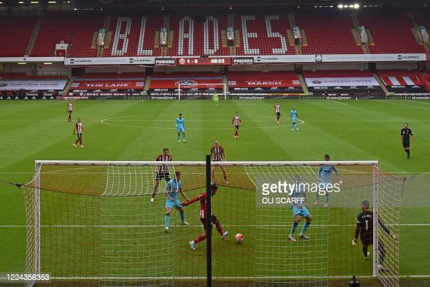 Sheffield United's French striker Lys Mousset scores their second goal during the English Premier League football match between Sheffield United and...