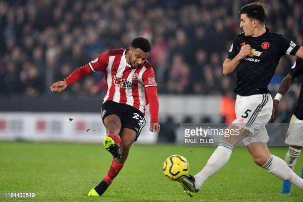 Sheffield United's French striker Lys Mousset shoots past Manchester United's English defender Harry Maguire to score their second goal during the...