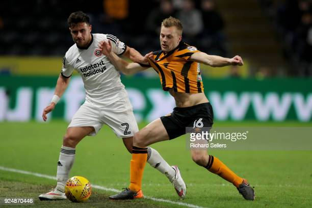 Sheffield United's George Baldock and Hull City's Sebastian Larsson challenge during the Sky Bet Championship match between Hull City and Sheffield...