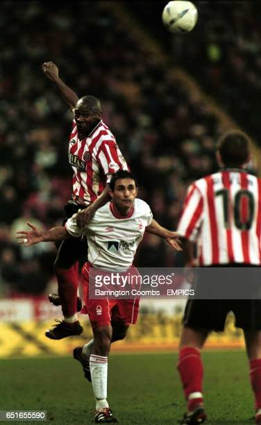 Sheffield United's Gus Uhlenbeek gets above Nottingham Forest's Jack Lester while teamate Paul Devlin watches