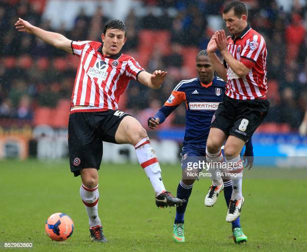 Sheffield United's Harry Maguire and Michael Doyle in action with Fulham's Hugo Rodallega