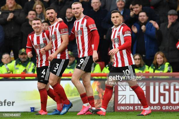 Sheffield United's Irish defender Enda Stevens celebrates with teammates after scoring the opening goal of the English Premier League football match...