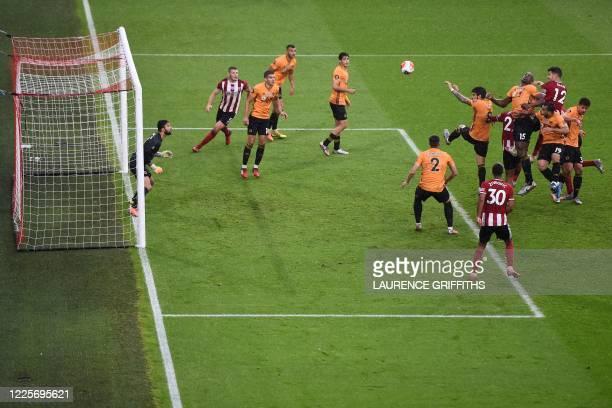 Sheffield United's Irish defender John Egan scores a goal during the English Premier League football match between Sheffield United and Wolverhampton...