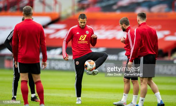 Sheffield United's Jack Rodwell warms up before the Premier League match between Sheffield United and Chelsea FC at Bramall Lane on July 11, 2020 in...