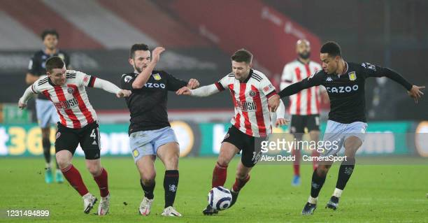 Sheffield United's John Fleck and Oliver Norwood vies for possession with Aston Villa's John McGinn and Ezri Konsa during the Premier League match...